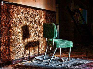 Green chair, seen in an abandoned packaging plant, Orange County NY Photo by Bill Roque