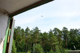 Military Plane Flying Over Abandoned Ammunitions Depot