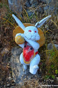 Red-Eyed Rabbit Statue With A Giant Mushroom