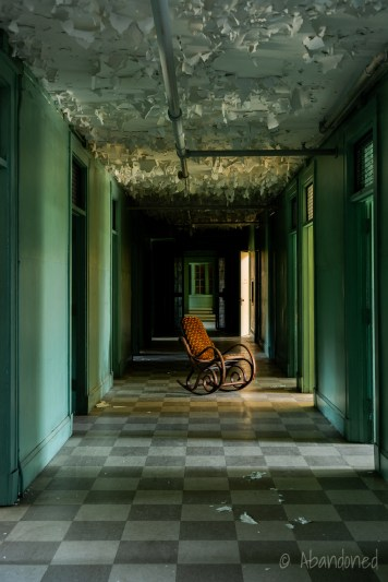 Medfield State Hospital Male Employees' Home Hallway with Lonely Wicker Chair