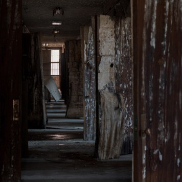 Trans-Allegheny Lunatic Asylum Hallway with Derelict Wood Doors