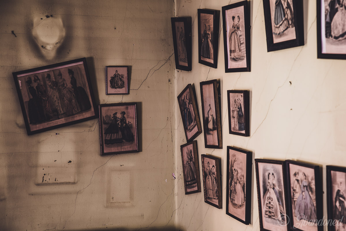 Abandoned Pictures Hanging on Wall