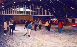 People ice skating indoors
