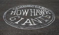 Mohawk Giants logo painted on asphalt surface of Hichliffe Baseball field