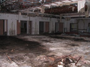 Large room with unfinished floor sheetrock walls
