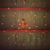 Mid century light fixture handing from ceiling