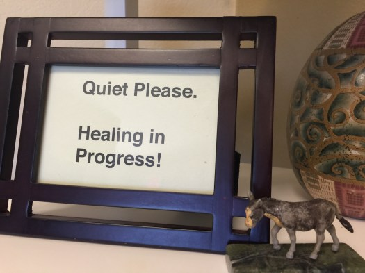 "Image of sign that reads. ""Quiet Please. Healing in Progress."""