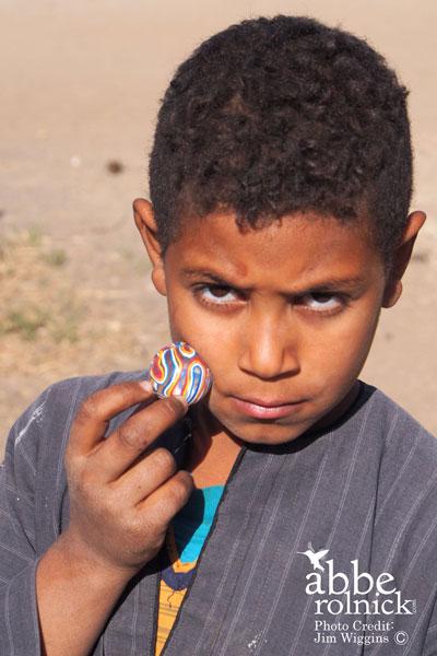 boy holding bouncy ball