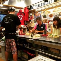 Chef prepares a local speciality in Hiroshima, okonomiyaki