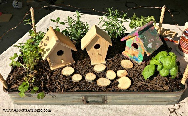 This DIY LED Lighted Indoor Herb Garden Tray can be decorated with birdhouses, vintage decor, or turned into a fairy garden.