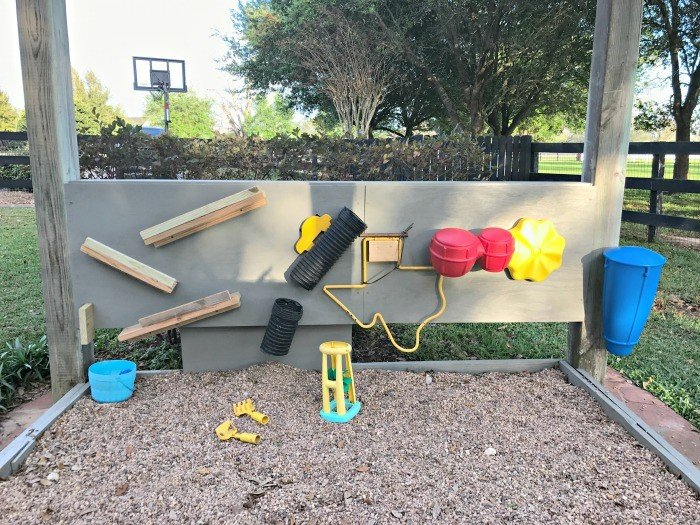 A Fun Pea Gravel Play Area & Backyard Activity Wall