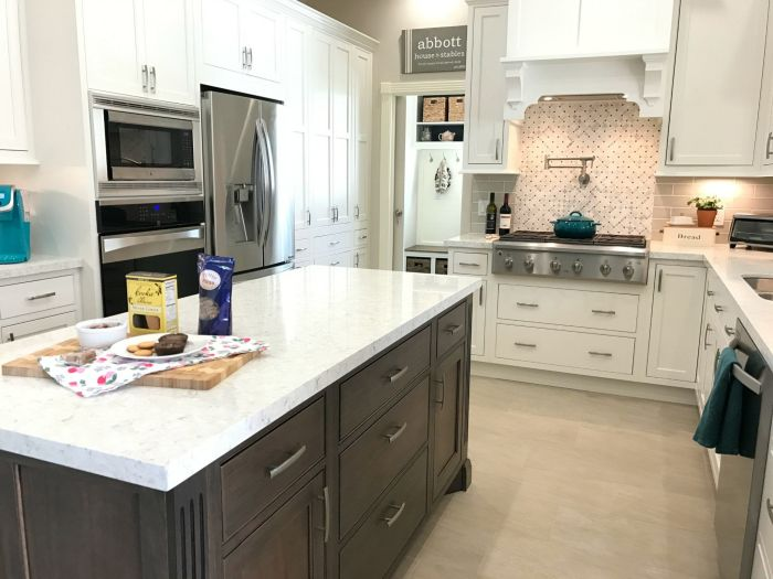 See the reveal for our White Modern Farmhouse Kitchen Makeover with Starmark Kitchen Cabinets and Lusso Quartz from Silestone. With design tips for better function with work stations and our 3 regrets.