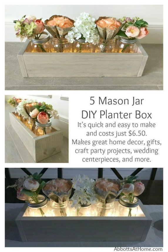 Make this quick and easy DIY 5 Mason Jar Planter Box for just $6.50. Makes great home decor, gifts, craft party projects, wedding centerpieces, and more. Can be sold at craft fairs and online too. #masonjar #diy #centerpiece