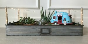 This LED Lighted Indoor DIY Succulent Garden Tray is a quick and easy DIY. Fill with your favorite succulents and vintage truck or camper to give it some charm.