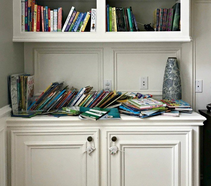 Before shot of messy kids books. Plywood DIY Kids Book Storage Ideas. Works with Lumber & MDF too. This is a great scrap wood build.