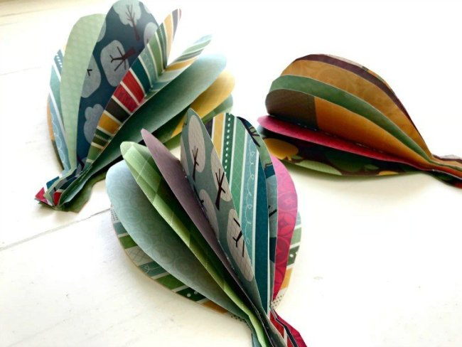Learn How to Make Paper Hot Air Balloon Wall Art with cute double-sided scrap book paper. This tutorial is easy and works great on walls or as a mobile in a kid's room.