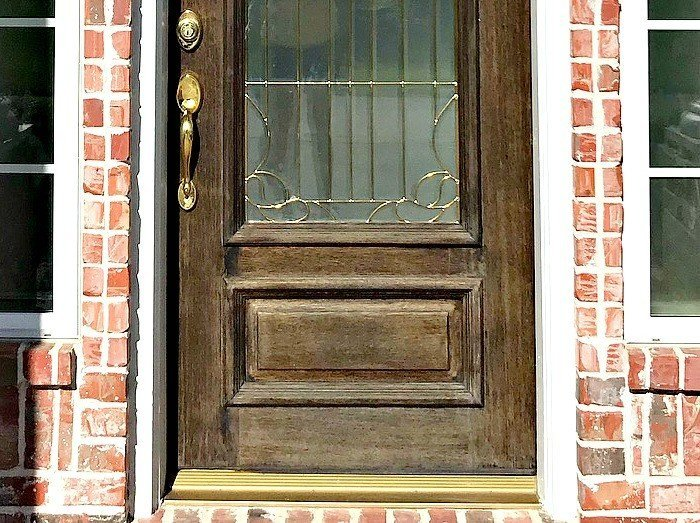 Quick & easy DIY for how to restain a door without stripping off the old wood finish. Just give the door a quick cleaning and light sanding. You can leave the old finish in place. This front door makeover works over old stain! #stain #frontdoor