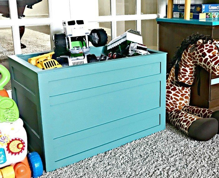 Teal Farmhouse Fun Kids DIY Storage Box. Build a Modern Farmhouse DIY Wooden Toy Storage Crate or Box for all of those kids toys cluttering up your house. Makes a beautiful throw pillow and blanket box in a Living Room or catch all storage box for teens too! #AbbottsAtHome #StorageBox #ToyBox #DIYStorage