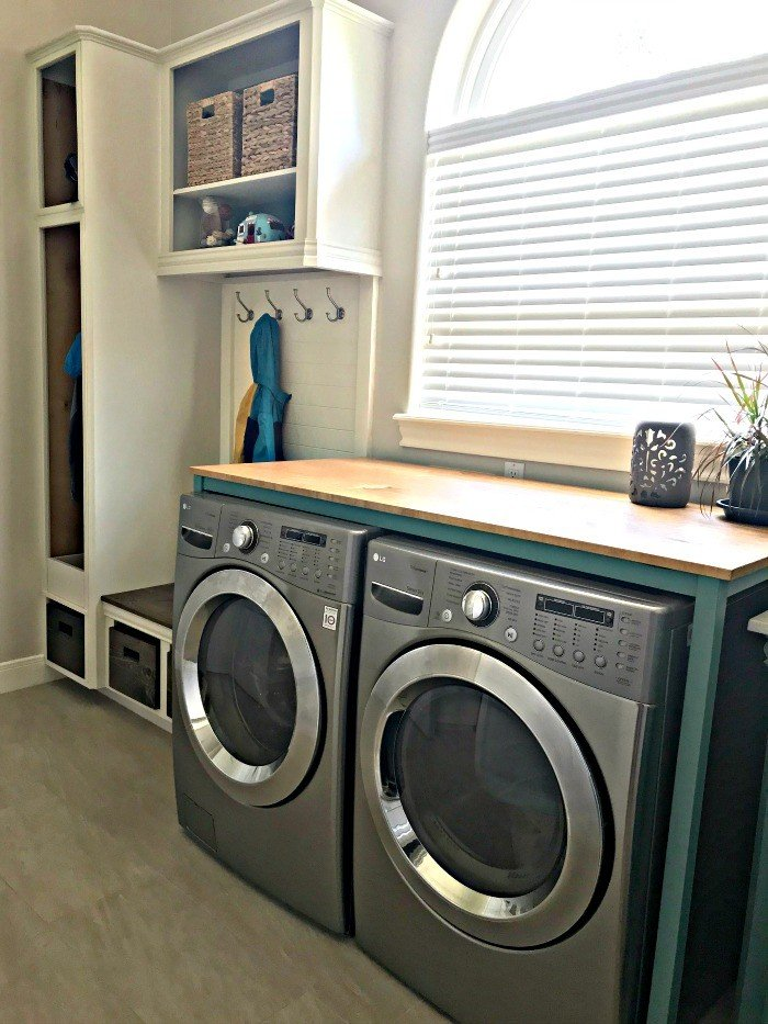 Free Plans for this Over Washer and Dryer DIY Laundry Table. This simple build hides those ugly machines, adds extra style and organization. And works as a Laundry Folding table too! #LaundryTable #LaundryFoldingTable #DIYFurniture #LaundryRoomIdeas #AbbottsAtHome