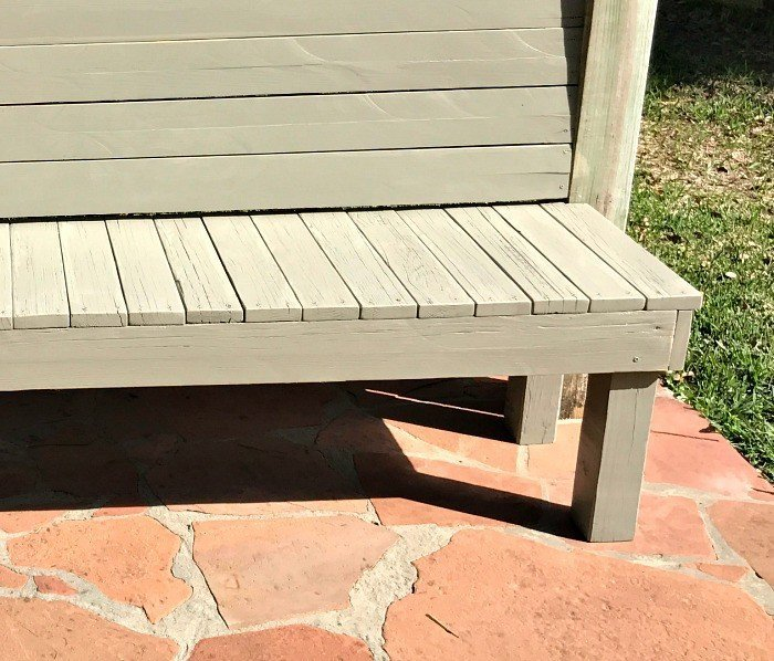 Build this DIY Rustic Farmhouse Outdoor Bench with just a drill and a saw. This is a great 2x4 bench project. #AbbottsAtHome #DIYBench #DIYFurniture #2x4bench