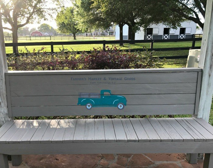 A grey rustic, scrap wood 2x4 bench. Build this DIY Rustic Farmhouse Outdoor Bench with just a drill and a saw. This is a great 2x4 bench project. #AbbottsAtHome #DIYBench #DIYFurniture #2x4bench