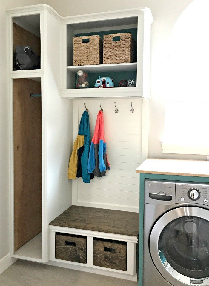 DIY Coat and shoe storage. A fresh Modern Farmhouse look using teal, wood, and lots of white. This Modern Farmhouse Small Laundry Room Design is full of easy DIY projects and affordable decor. #LaundryRoom #ModernFarmhouse #Teal #AbbottsAtHome
