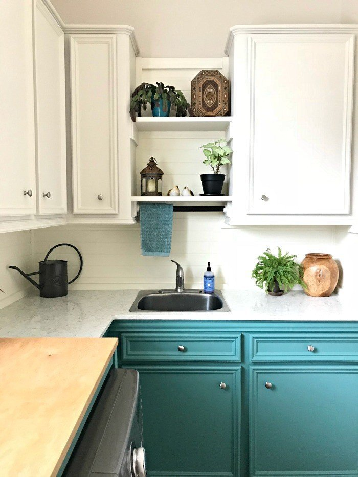 A matching light colored paint scheme on the walls and upper cabinets makes this laundry room feel more open! #AbbottsAtHome #LightWalls #WhiteWalls #GreyWalls #PaintIdeas