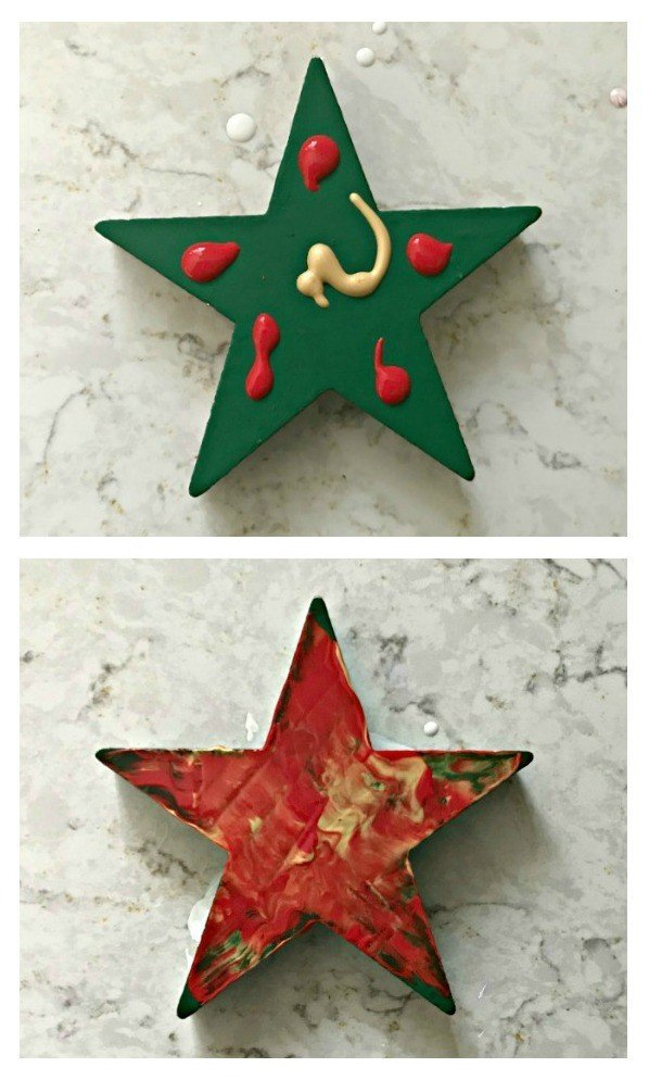 Paint Smear Ornament. Need some new ideas for this years Christmas craft? I've got 12 fun and easy handmade Christmas Ornament Ideas for you! Make 3D scrapbook paper trees, pom pom trees, star string art, unicorn stars, and more. #AbbottsAtHome #Handmade #ChristmasCrafts #ChristmasIdeas #ChristmasOrnaments