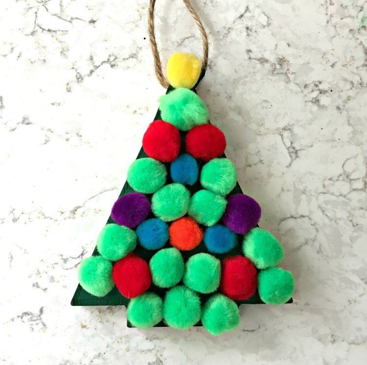 Pom Pom Tree Ornament. Need some new ideas for this years Christmas craft? I've got 12 fun and easy handmade Christmas Ornament Ideas for you! Make 3D scrapbook paper trees, pom pom trees, star string art, unicorn stars, and more. #AbbottsAtHome #Handmade #ChristmasCrafts #ChristmasIdeas #ChristmasOrnaments