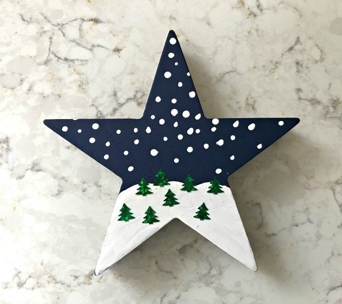 Snowy Landscape Ornament. Need some new ideas for this years Christmas craft? I've got 12 fun and easy handmade Christmas Ornament Ideas for you! Make 3D scrapbook paper trees, pom pom trees, star string art, unicorn stars, and more. #AbbottsAtHome #Handmade #ChristmasCrafts #ChristmasIdeas #ChristmasOrnaments