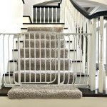Here's a cheap and easy DIY that I have loved for 4 years. It's myDIY Baby Gate Hack for Stairs. And, this thing is sturdy. My boys have both stood at that gate and shook it back and forth. And it did not budge at all. Yaasss! Here's my tutorial for how to make this baby gate work for stairways and banisters. Works with wide openings too. #AbbottsAtHome #Stairways #BabyGate #Babyproof #BabySafety #HomeDIY #HomeSafety