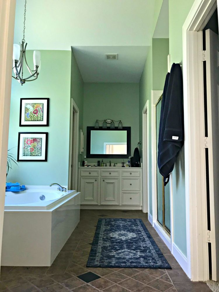 Here's a look at our Master Bathroom before the big makeover. It has 2 vanities, a big roman tub in front of a bay window and a walk in shower.