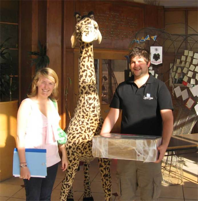 ABC bike and hike challenge - Chris and Megan arrive at the charity bearing gifts for the children.