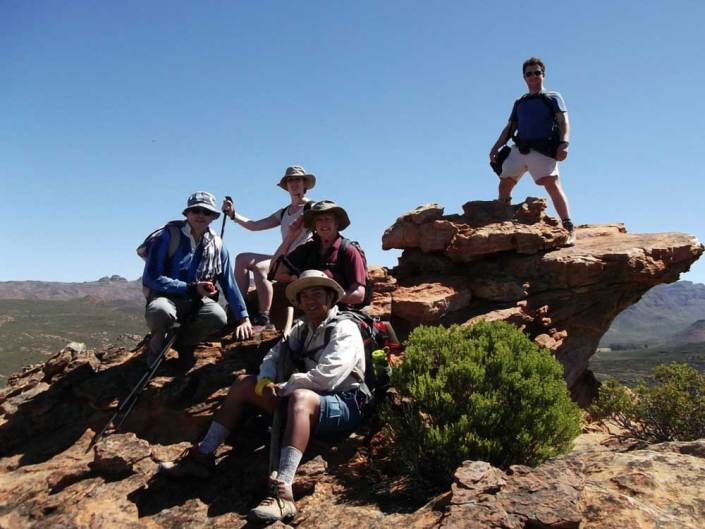 ABC bike and hike challenge - The hikers take a group photo at the top of the mountain.