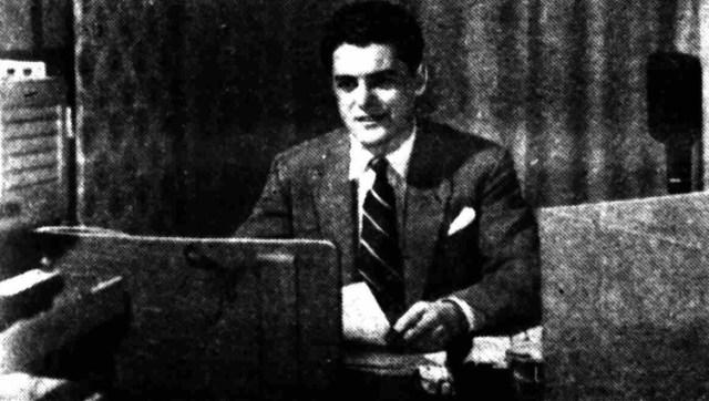 John Edmunds behind the announcer's desk