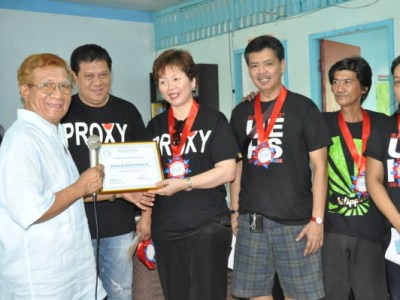 Rev. Vicente Y. Oriel, Chairman of ABC Philippines, Presenting a Plaque of Appreciation to UE HS Batch '82