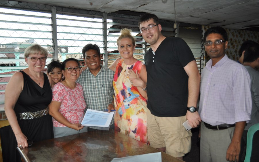 Pr. & Mrs. Bobot receive a check of PHH 588,000 from Andreasen family