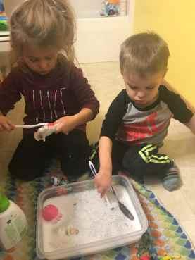 Toy washing sensory bin for kids