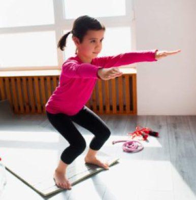 child doing squat exercise