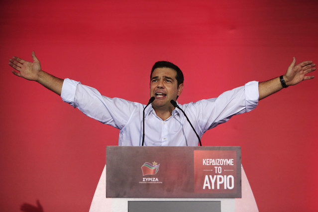 Syriza left-wing party leader and former Prime Minister Alexis Tsipras gestures as he delivers a pre-election speech to his supporters at Syntagma square in central Athens, Friday, Sept. 18, 2015. Opinion polls indicate a race too close to call, with Tsipras struggling to maintain the narrowest of leads over his main opponent, center-right New Democracy leader Vangelis Meimarakis. (AP Photo/Lefteris Pitarakis)