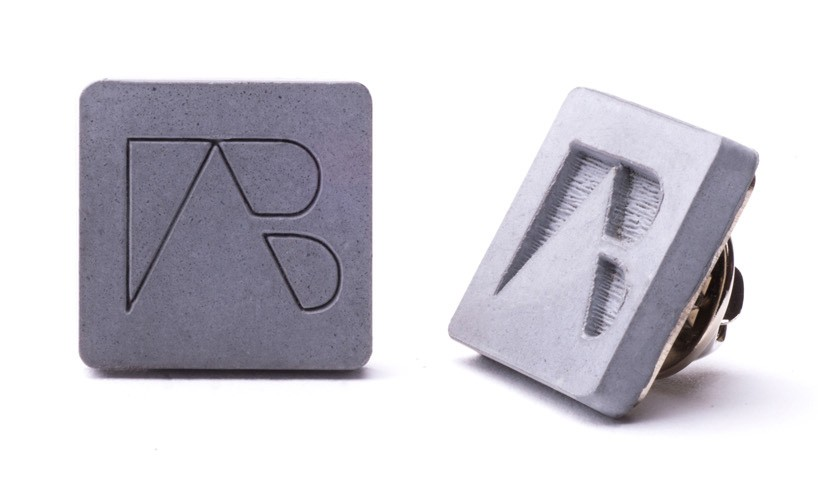 Concrete pin with engraved custom made logo for employees