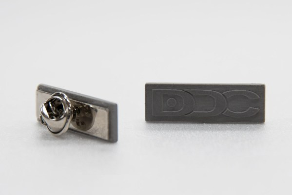 Brand identity concrete pins for building material company's corporate uniform