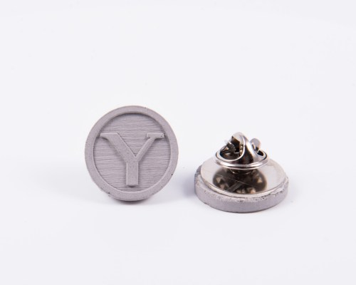 Custom made brand identity concrete pins for university students