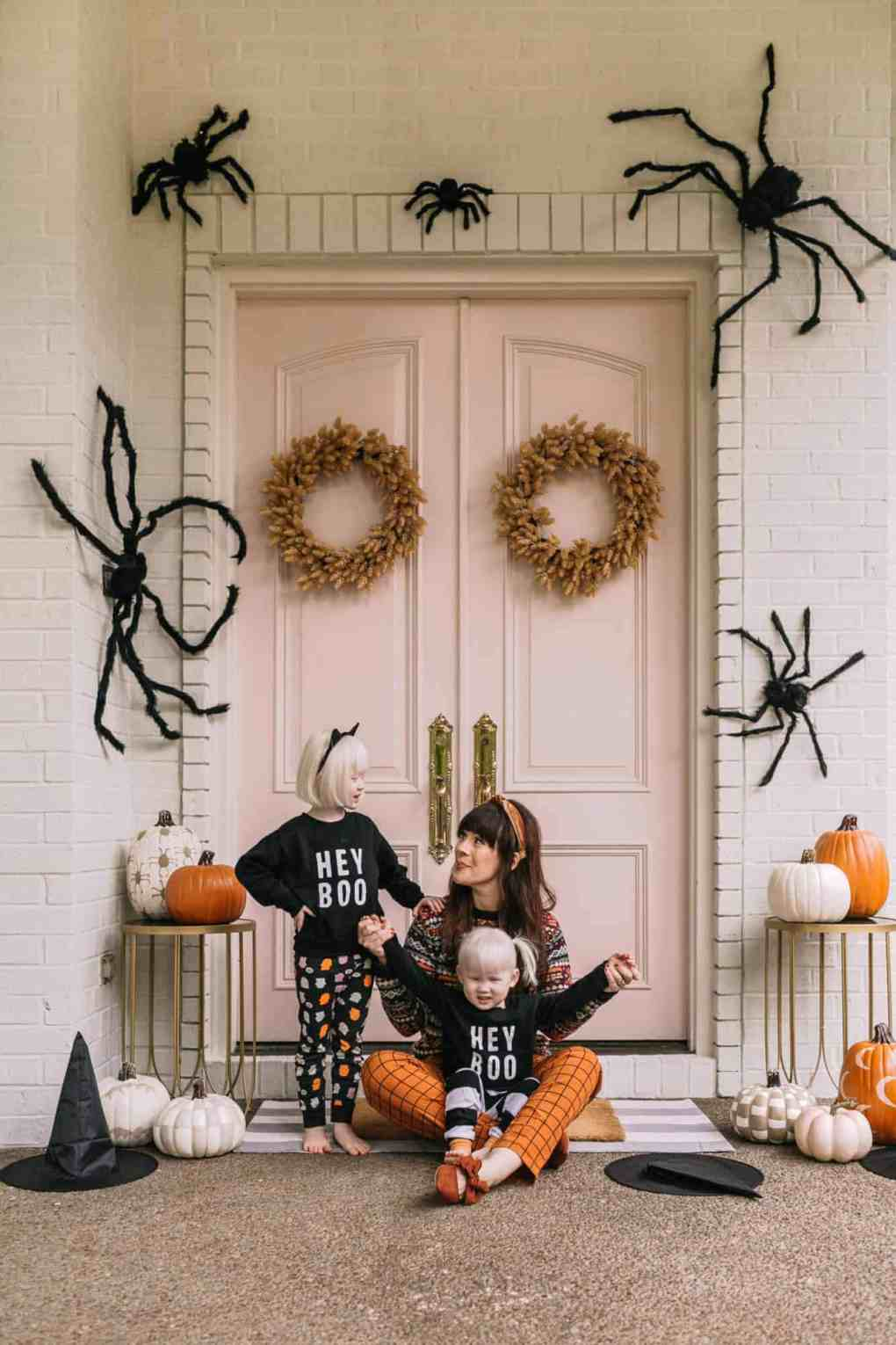 front porch decorated for halloween with spiders and bats
