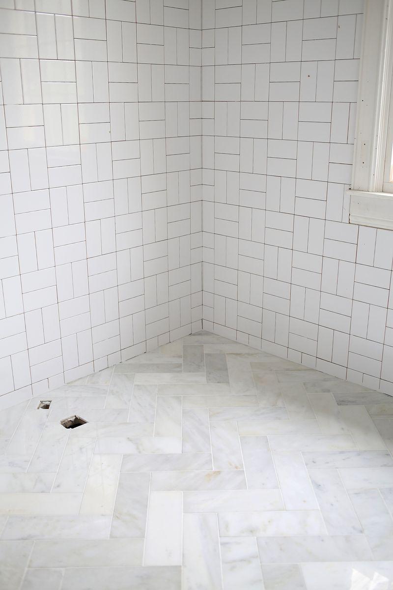 try this herringbone marble tile a