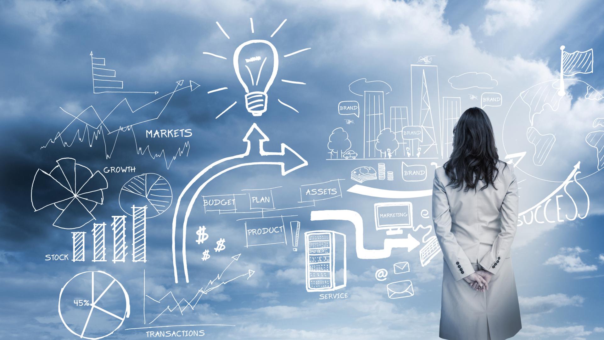 Imagem de uma mulher com jaleco observando algumas ilustrações de gráficos e mais