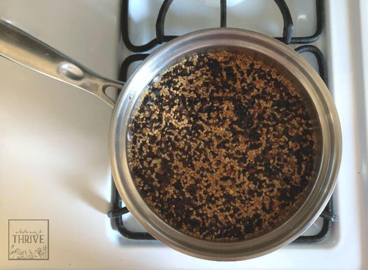 saucepan with ingredients for elderberry syrup