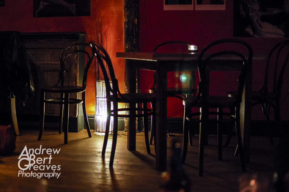 empty chairs and table in a bar