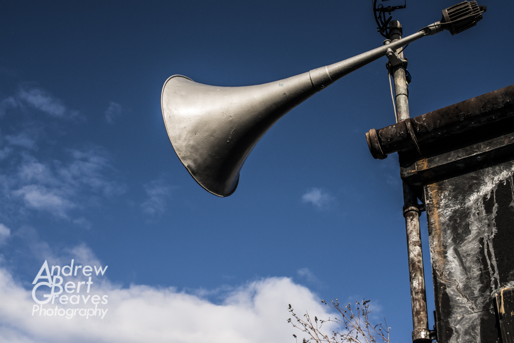 an old horn shaped speaker for a public address system