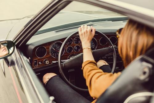 Woman driving in car picture.